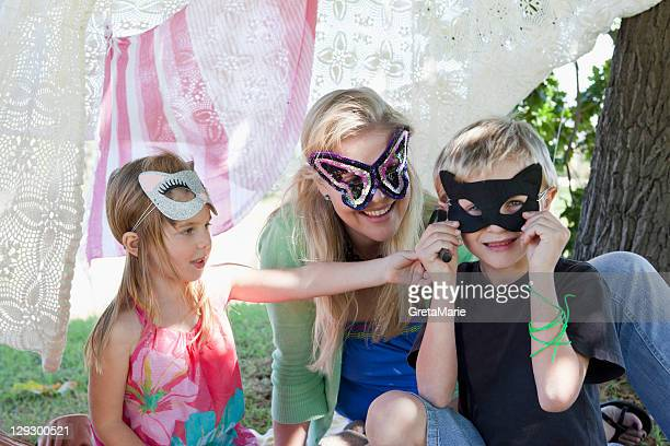 Mother and children wearing masks