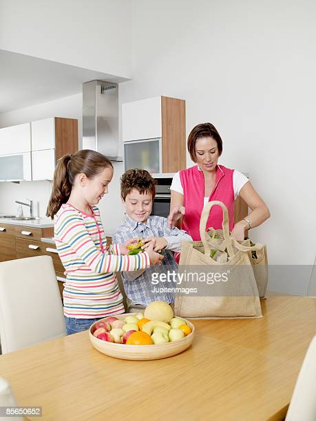 Mother and children with groceries