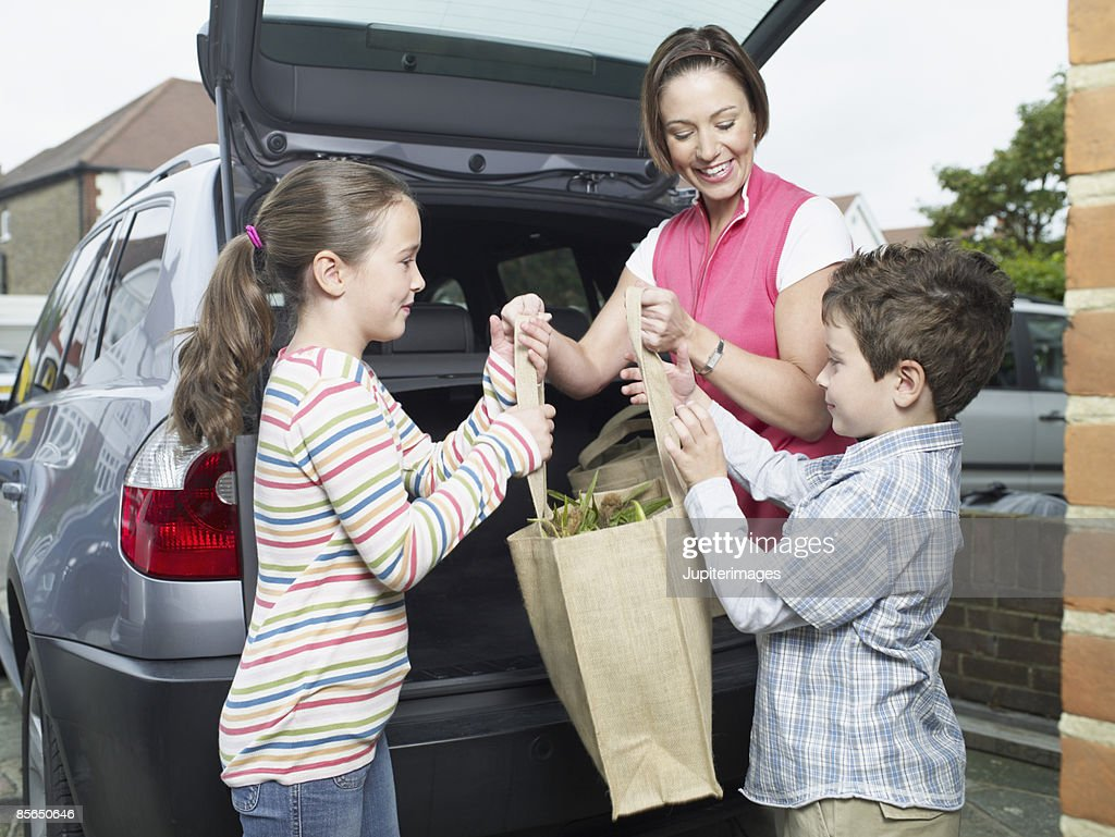 Mother and children with reusable grocery bag : Stock Photo