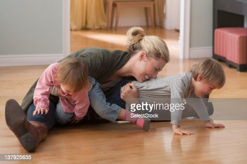 Mother and children wrestling