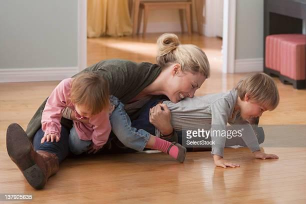 Mother and children wrestling