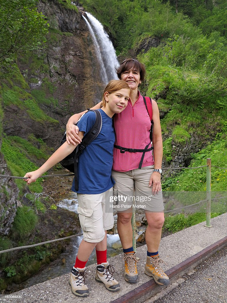 mother and daughter at a hiking tour : Stock Photo