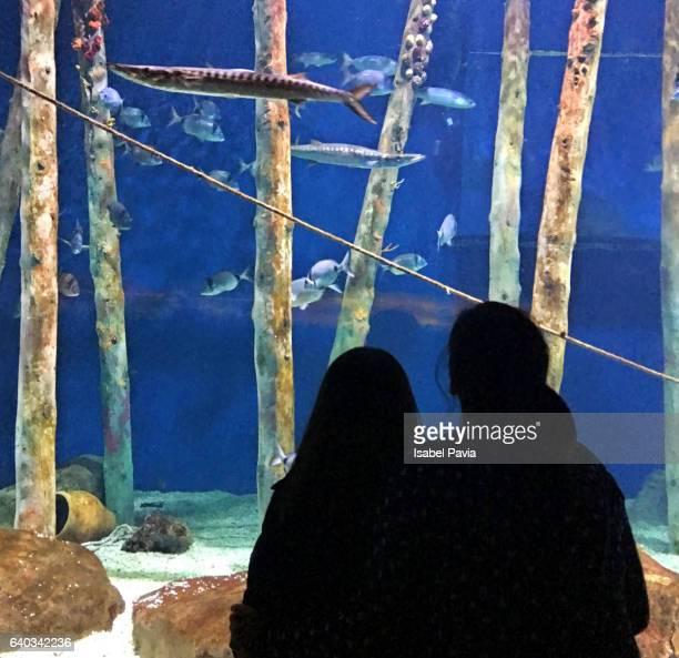 Mother and daughter at aquarium