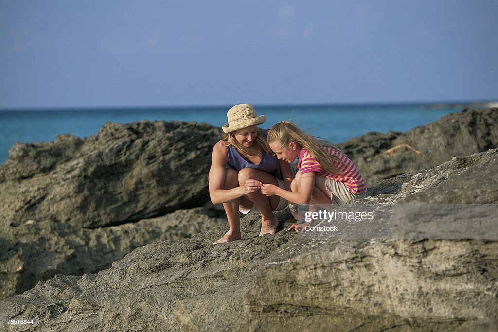 Mother and daughter at beach : Stock Photo