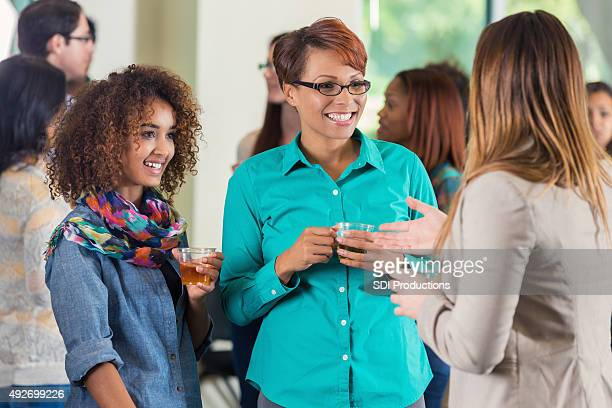 Mother and daughter at college meet and greet party