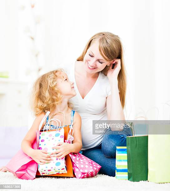 Mother and daughter at home after shopping