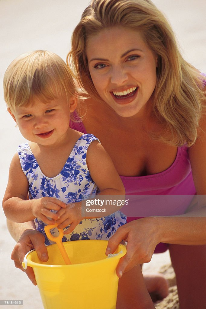 Mother and daughter at the beach : Stock Photo