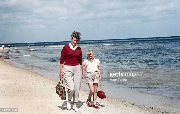 mother and daughter at the beach walking