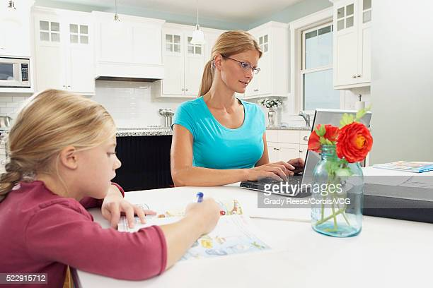 Mother and daughter at work