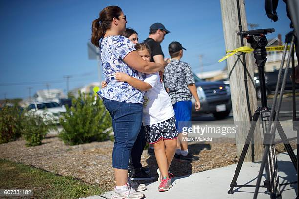 Mother and daughter Audrey King and Alina embrace near the scene of an 'pipe bombstyle device' explosion on September 17 2016 in Seaside Park New...