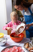 Mother and daughter baking a chocolate cake