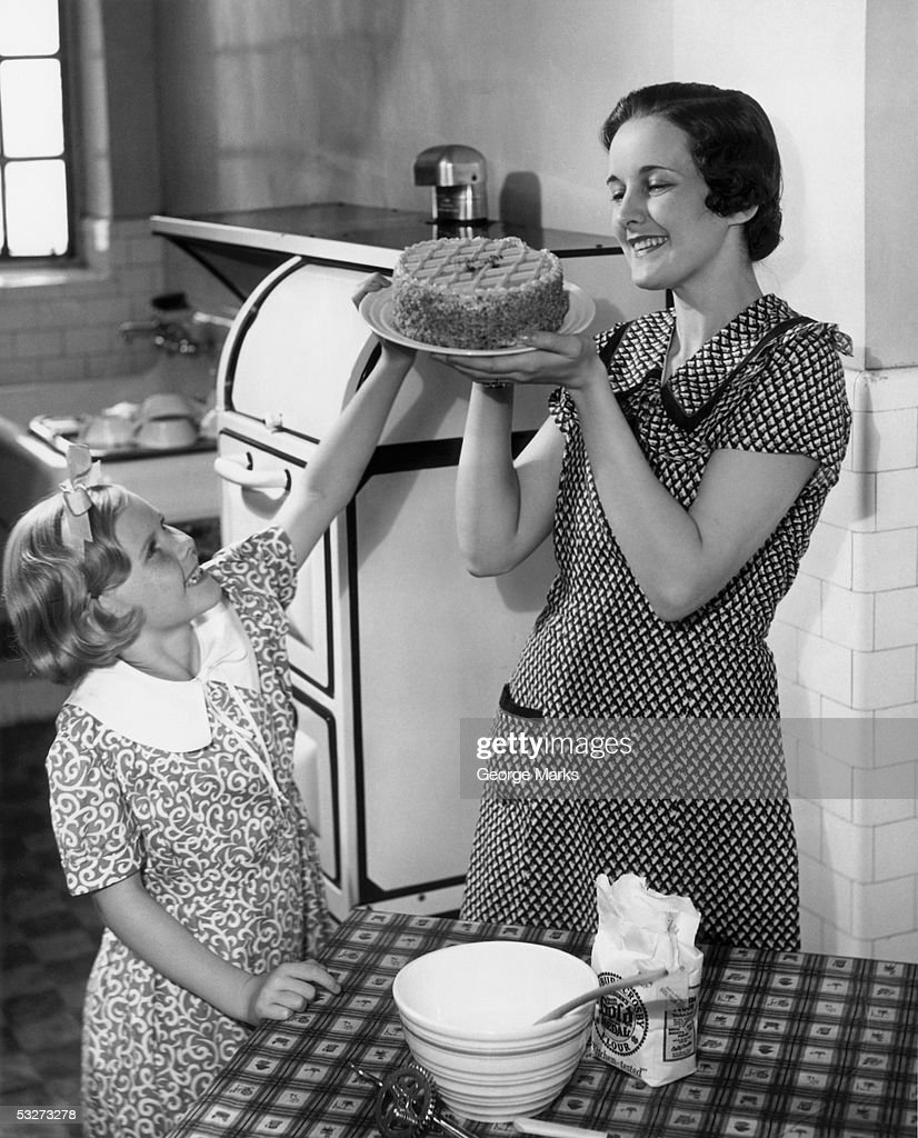 Mother and daughter baking cake : Stock Photo
