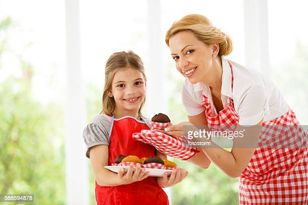 Mother and daughter baking cakes