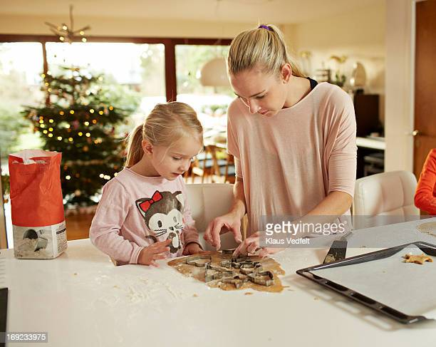 Mother and daughter baking for christmas