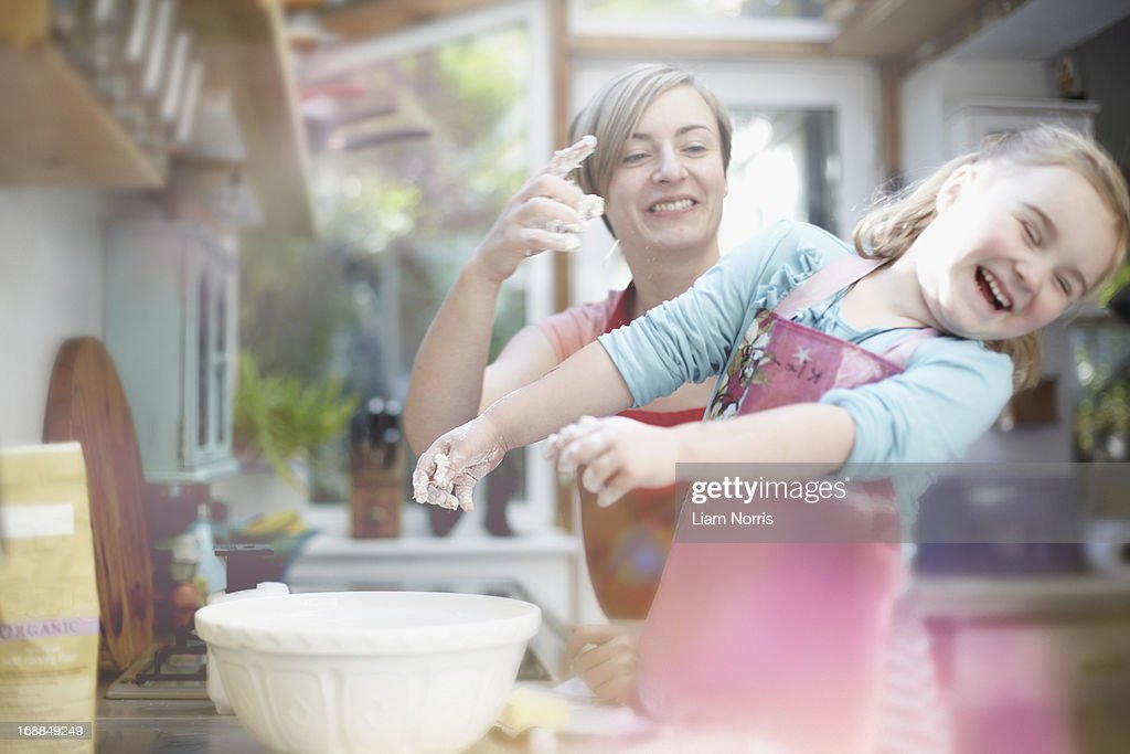 Mother and daughter baking together : Stock Photo