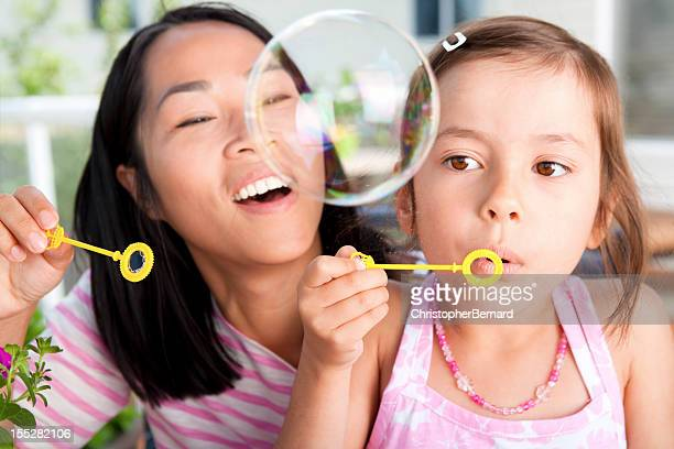 Mother and Daughter blowing bubble