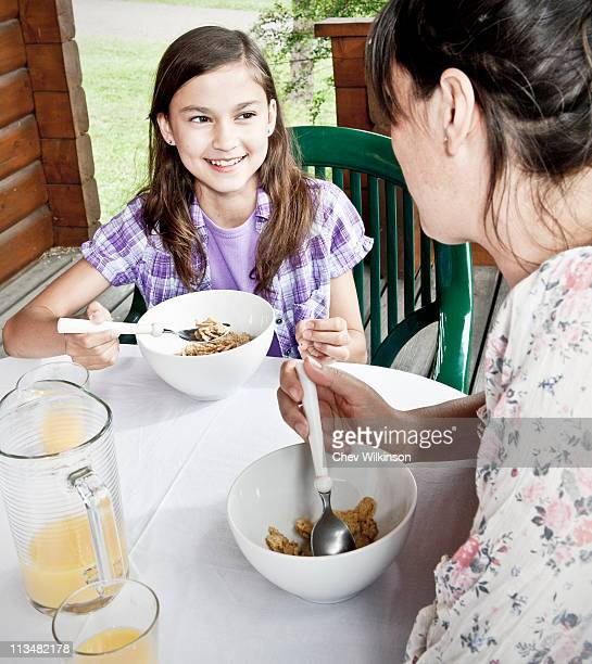 Mother and daughter breakfast together