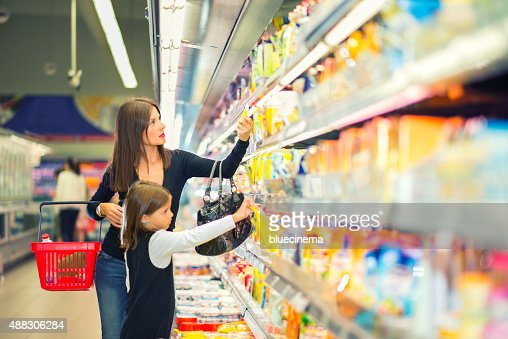 Mother and daughter buying in supermarket