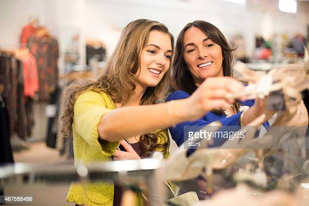 mother and daughter buying shoes in a department store