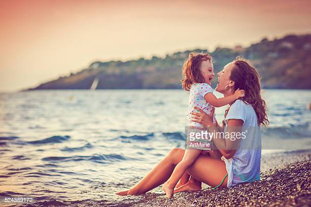 Mother and daughter by the sea
