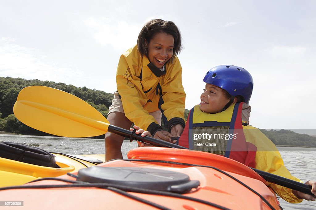 mother and daughter canoeing : Stock Photo