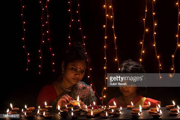Mother and daughter celebrating diwali