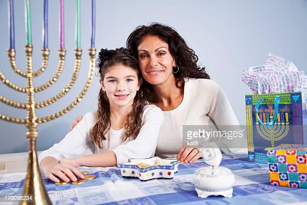 Mother and daughter celebrating Hanukkah
