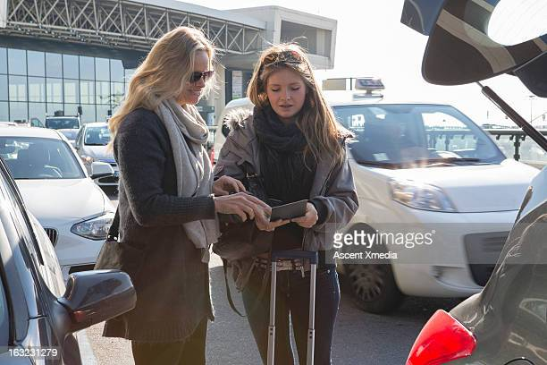 Mother and daughter check travel documents,airport