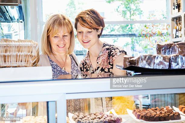mother and daughter choosing chocolates.