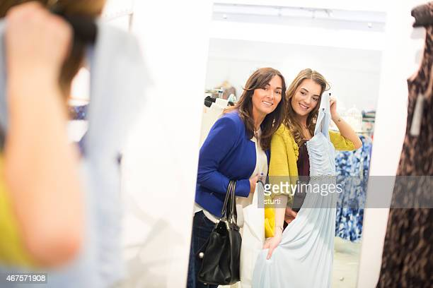 mother and daughter choosing dresses