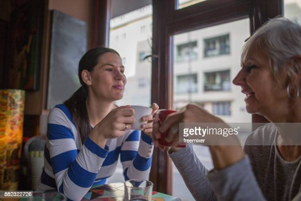 Mother and daughter coffee time