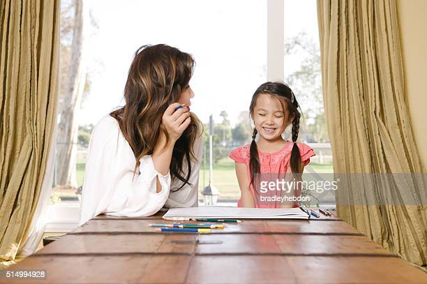 Mother and daughter coloring in together