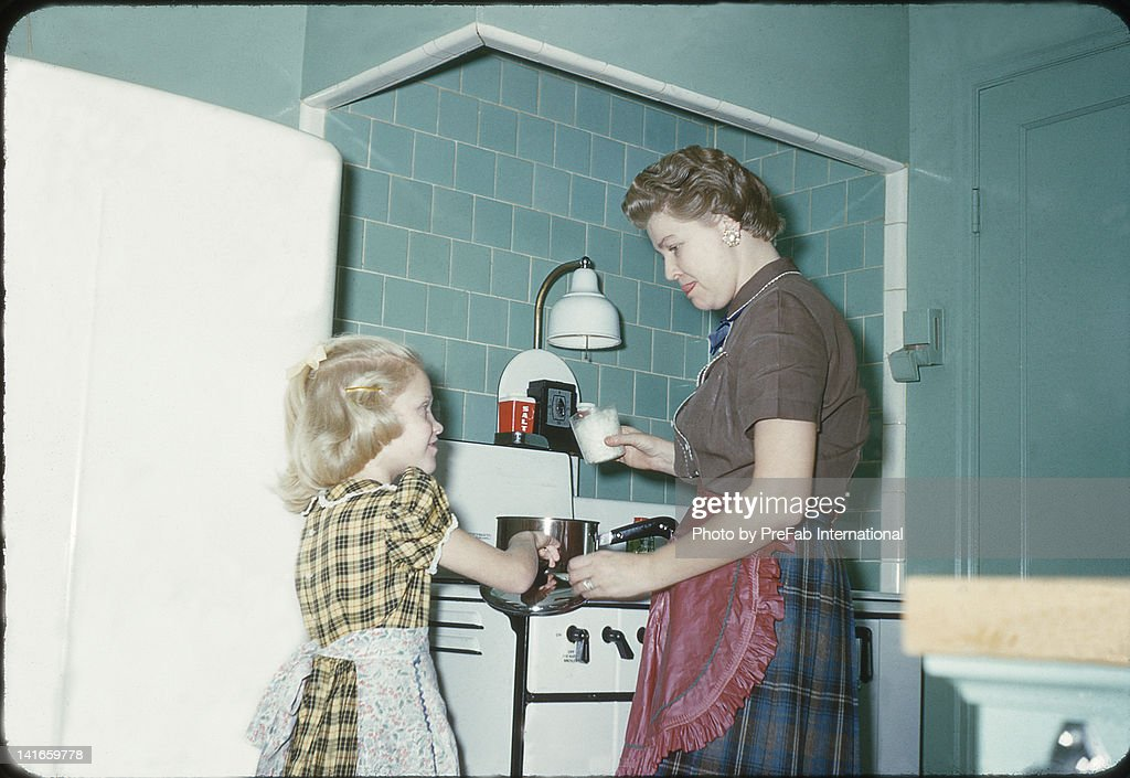 Mother and daughter cooking in kitchen : Stock Photo