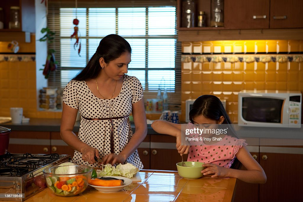 Mother and daughter cooking in the kitchen : Stock Photo