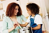 Mother and daughter cooking in the kitchen