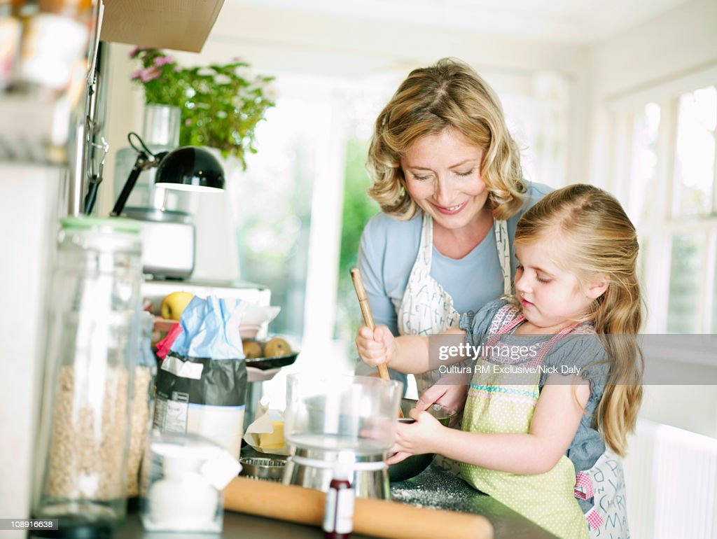 A mother and daughter cooking : Stock Photo