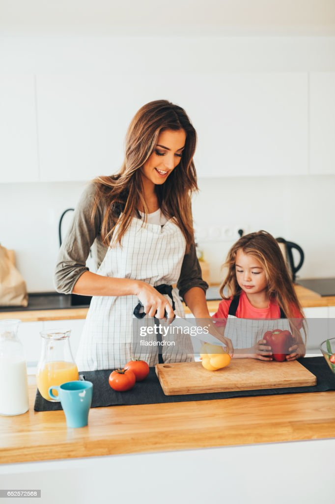 Mother and daughter cooking : Stock Photo
