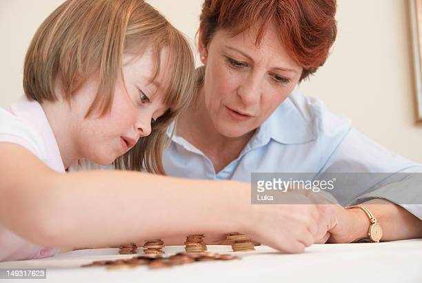 Mother and daughter counting coins