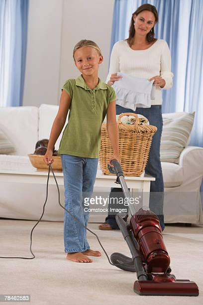 Mother and daughter doing chores