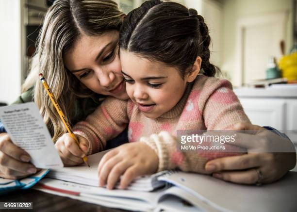 Mother and daughter (7 yrs) doing homework