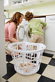 Mother and daughter doing laundry together