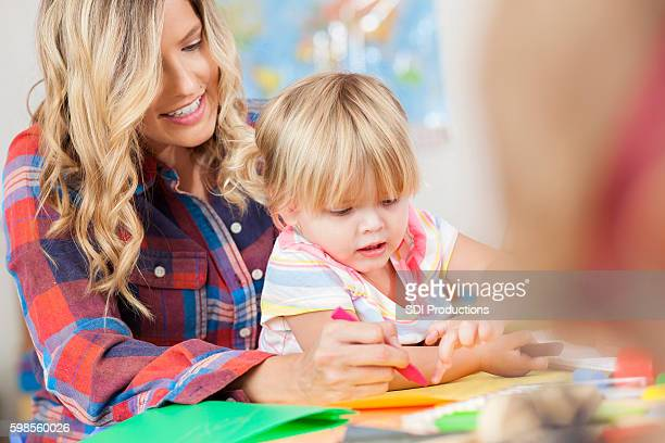 Mother and daughter draw together during preschool class