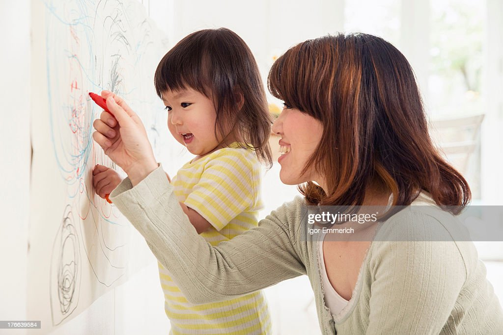 Mother and daughter drawing : Stock Photo
