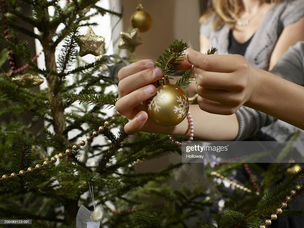 Mother And Daughter Dressing Christmas Tree Closeup Stock Photo ...