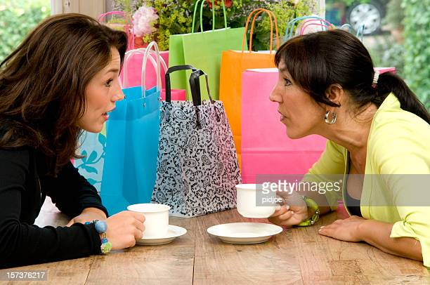 mother and daughter drinking coffee after shopping