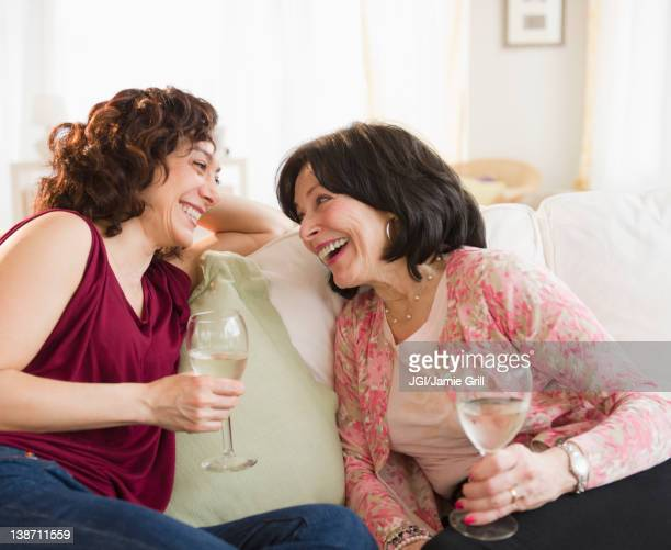 Mother and daughter drinking wine together