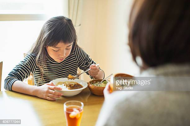 Mother and daughter eating lunch together on holiday