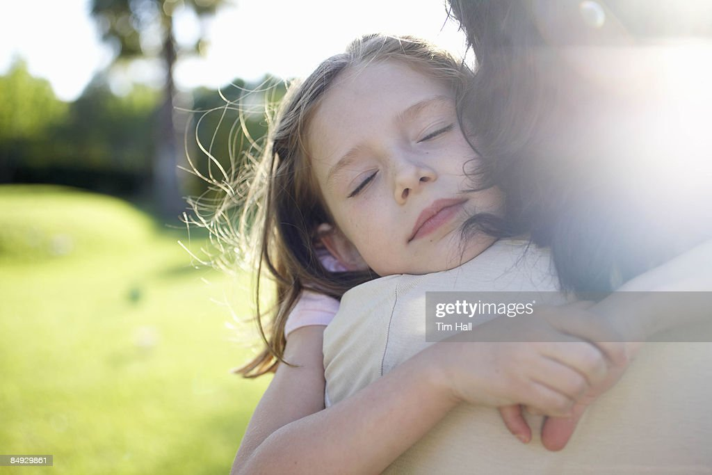 Mother and daughter embracing : Stock Photo