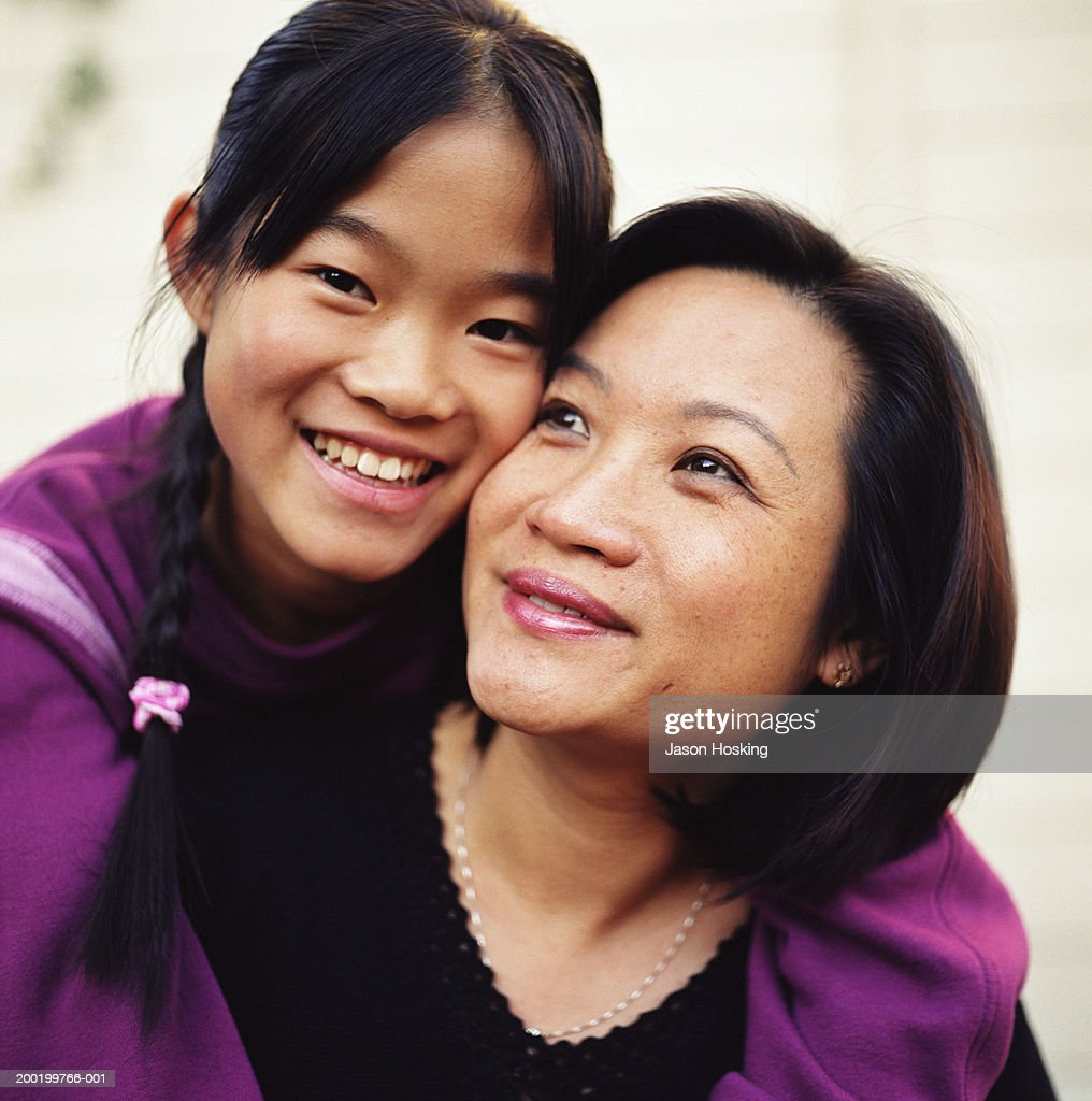 Mother and daughter (12-14) embracing, portrait : Stock Photo