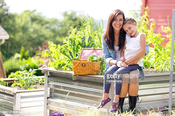 Mother and daughter enjoy gardening together outdoors